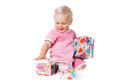 Happy infant girl with gift boxes on white Royalty Free Stock Photo