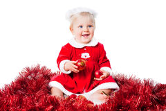 Happy infant girl wearing Santa suit isolated Royalty Free Stock Image