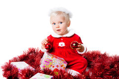 Happy infant girl wearing Santa suit isolated Royalty Free Stock Photo