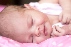 Happy Infant sleeping Royalty Free Stock Photography