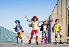 Happy skaters having fun at stadium royalty free stock image