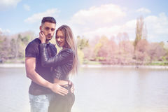 Happy inlove couple in the park Stock Images