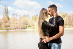 Happy inlove couple in the park Royalty Free Stock Images