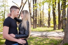 Happy inlove couple in the park Royalty Free Stock Photography