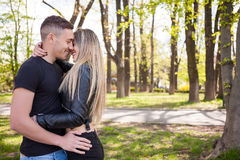 Happy inlove couple in the park Royalty Free Stock Image
