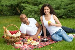 Happy international couple having a picnic Stock Image