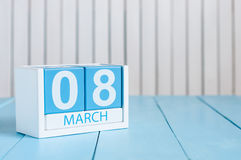 Happy International Women's Day. March 8th. Image of march 8 wooden color calendar on white background.  Empty space for Royalty Free Stock Images