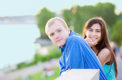 Happy interracial couple standing together outdoors Royalty Free Stock Photo
