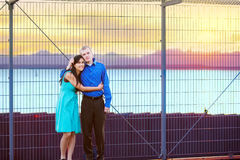 Happy interracial couple standing together outdoors Stock Images
