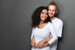 Happy interracial young couple Royalty Free Stock Photos