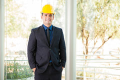 Happy investor wearing a helmet Stock Images