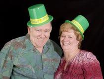 Happy Irish Couple. Happy Irsih couple isolated on black Royalty Free Stock Photography
