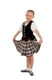 Happy Irish Dancer Girl. Cheerful Young Irish National Dancer in Ghillies and Performance Tartan Stock Photo
