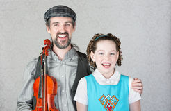 Happy Irish Musician with Child and Fiddle Stock Photos