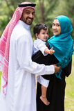 Happy islam family. Looking back stock photo