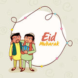 Happy Islamic people celebrating Eid Mubarak festival. Happy Islamic men hugging and giving gifts to each other on occasion of Muslim community festival, Eid Royalty Free Stock Photography