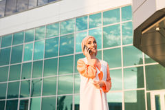Happy islamic woman using smart phone. Outdoors Royalty Free Stock Photography