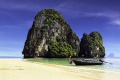 Happy Island and boat with blue sky in Krabi Royalty Free Stock Photography