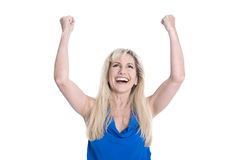 Happy isolated middle aged woman in blue with hands up. stock image