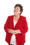 Happy isolated senior woman wearing red jacket. Stock Images