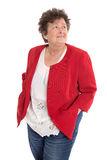 Happy isolated senior woman wearing red jacket looking sideways Royalty Free Stock Images