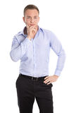Happy isolated young blond businessman in blue shirt. royalty free stock photography