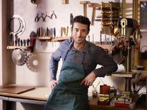 Happy italian artisan in guitar workshop Stock Photos