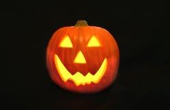 Happy Jack O' Lantern face. Smiling , lighted Jack O' Lantern Royalty Free Stock Image