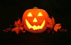 Happy Jack O' Lantern face. Smiling , lighted Jack O' Lantern Royalty Free Stock Images