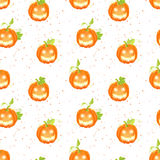 Happy Jack o lanterns on  dotted backdrop seamless vector patter Royalty Free Stock Images