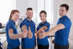 Happy Janitors Showing Thumb Up Sign Stock Photos