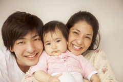 Happy japanese family Stock Images
