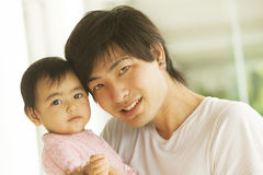 Happy japanese father and daughter Royalty Free Stock Photo