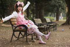 Happy japanese girl. In lolita cosplay fashion, Harajuku park, Tokyo royalty free stock photo