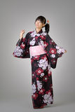 Happy japanese girl dancing Stock Images
