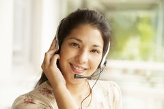 Happy japanese woman with headset Royalty Free Stock Photography