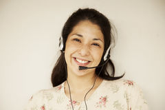 Happy japanese woman with headset Stock Photos
