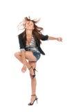Happy jazz brunette woman dancing Stock Photos