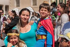 Happy jewish family celebrate the Purim holiday at street event royalty free stock photos