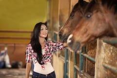 Happy jockey rider with horses royalty free stock photography