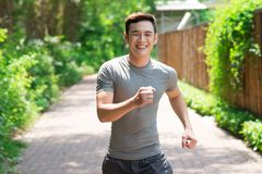 Happy jogger. Image of a laughing jogger going in for sports outside stock photography
