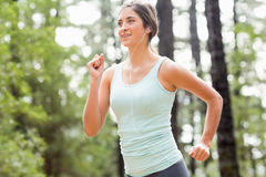Happy jogger running and listening to music Royalty Free Stock Photography