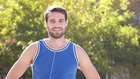 Happy jogger smiling at camera with thumbs up stock video footage