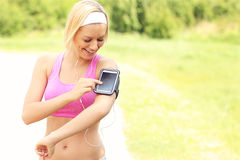 Happy jogger using a smartphone Stock Photos