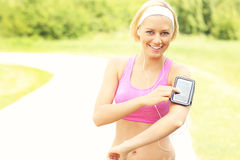 Happy jogger using a smartphone Stock Image