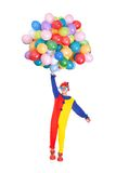 Happy Joker With Balloons. Portrait Of A Happy Clown With Multi Colored Balloons On White Background Stock Photography