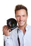 Happy journalist with digital. Happy smiling journalist with digital camera in his hand Stock Photos