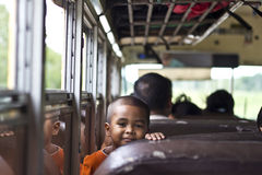 Happy journey. A young kid from Belize smiles during a long journey through the country on their traditional buses Royalty Free Stock Photo