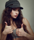 Happy joy teen girl in fashion cap with thumb up Royalty Free Stock Photo