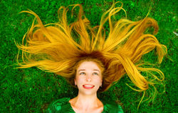 Happy joyful carefree woman with hair on grass Royalty Free Stock Photography